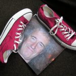Brian's signed shoes and headshot donated for the 2011 auction