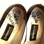 A close up of Anita's signed shoes