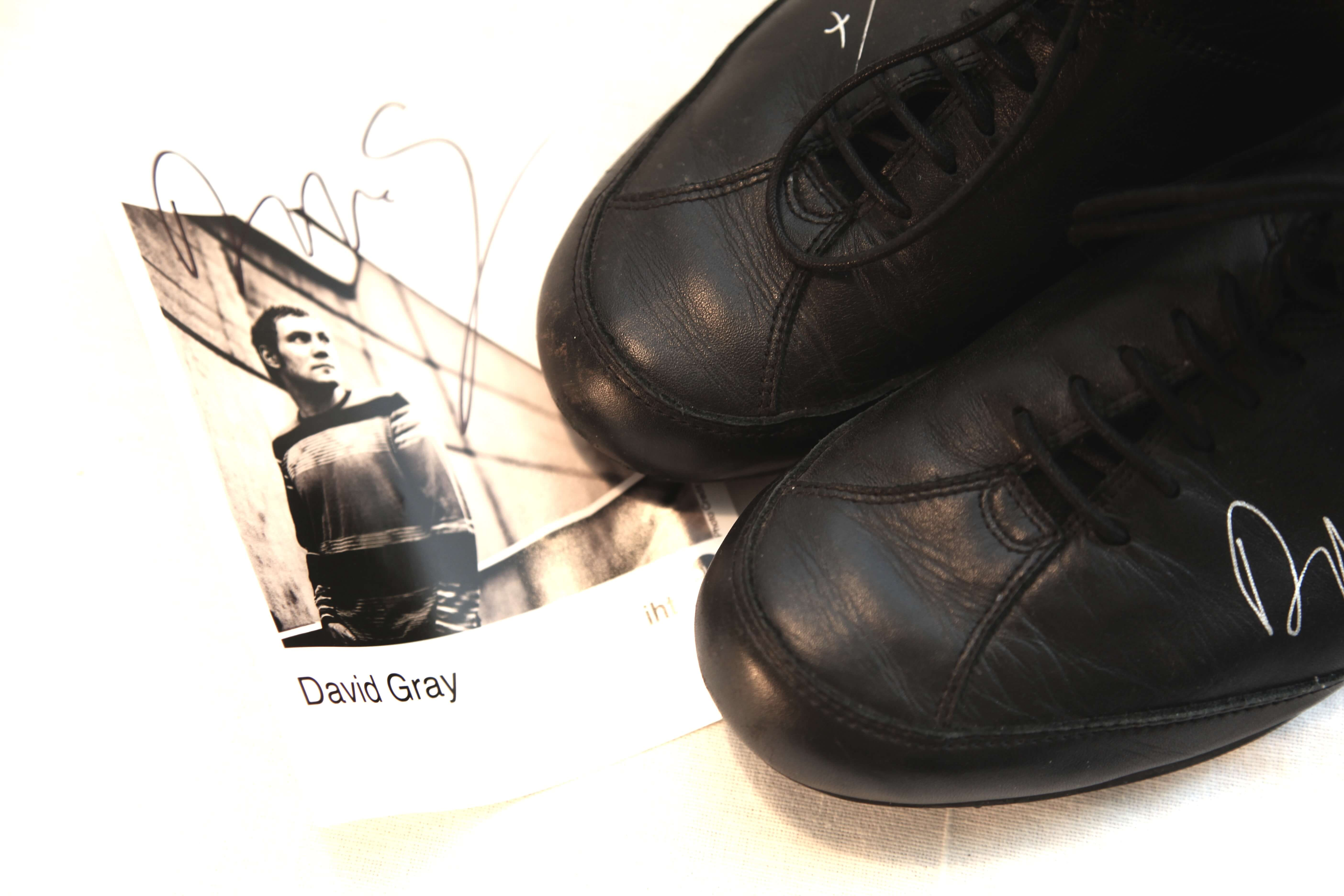 David's shoe donation and his signed autograph, which was also auctioned