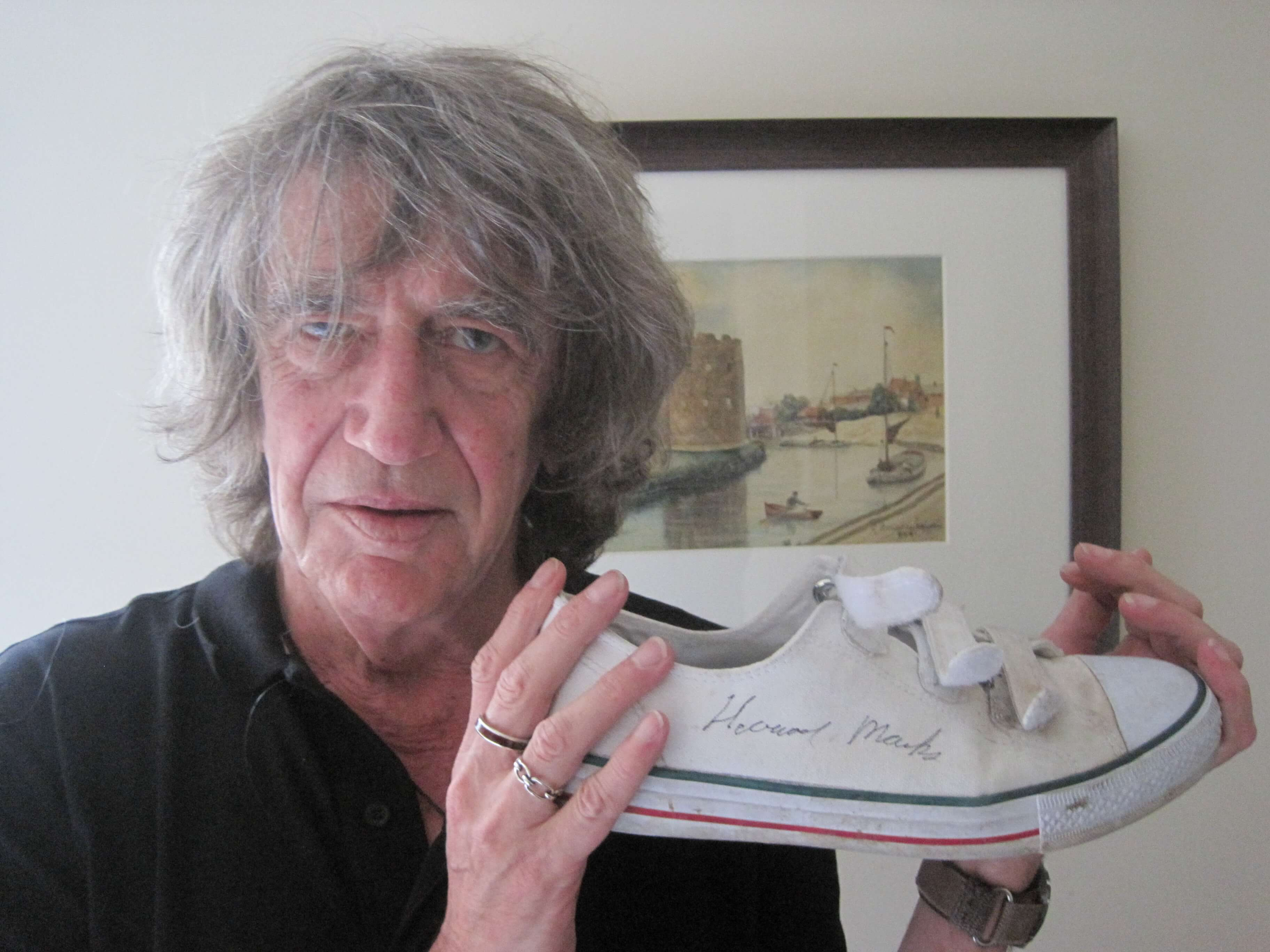 Howard Marks with the shoes he donated in 2011
