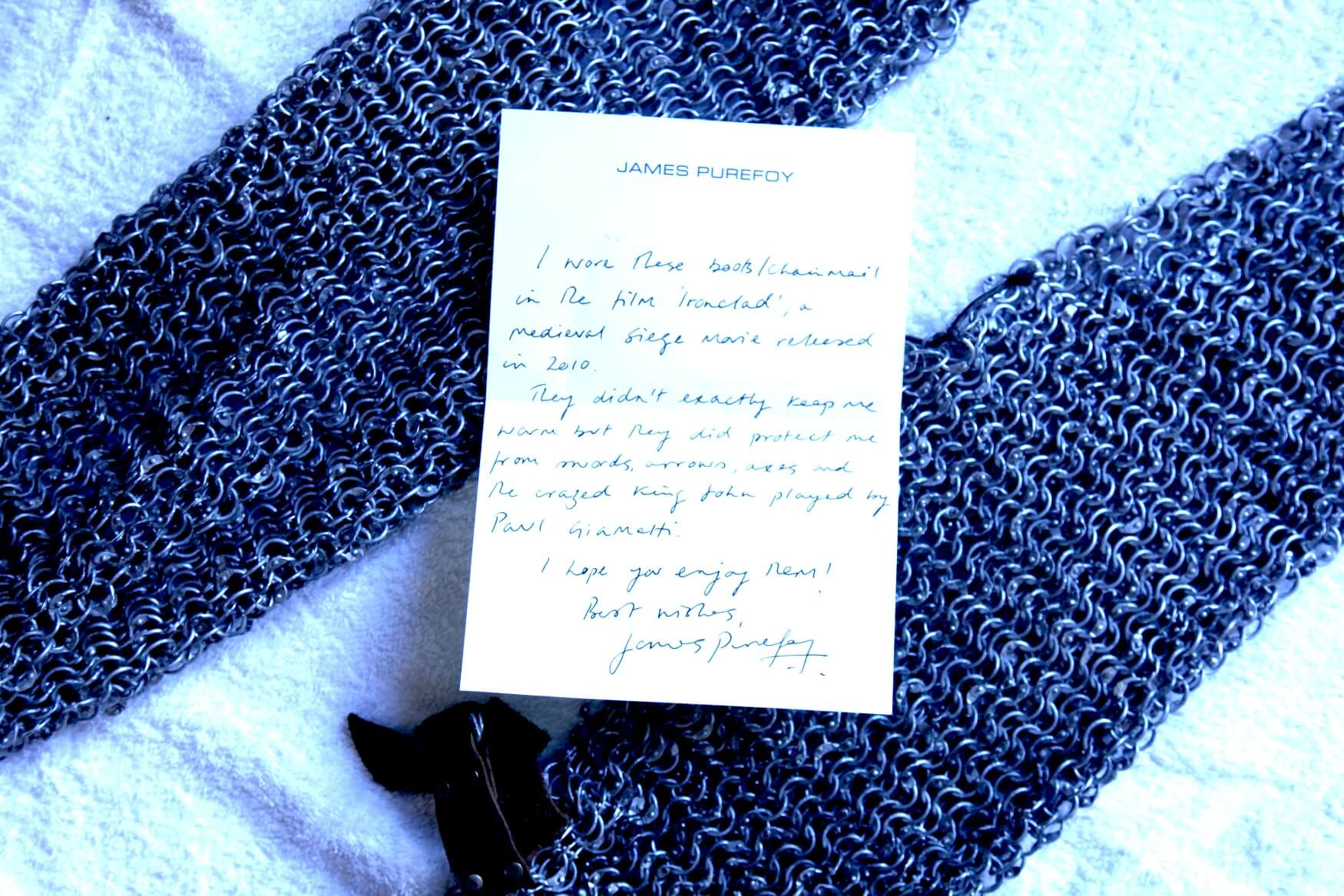 2011 He certainly didn't disappoint with his incredible donation of the authentic knight's chain-mail boots he wore on set filming Iron Clad.  He has even included a handwritten note.