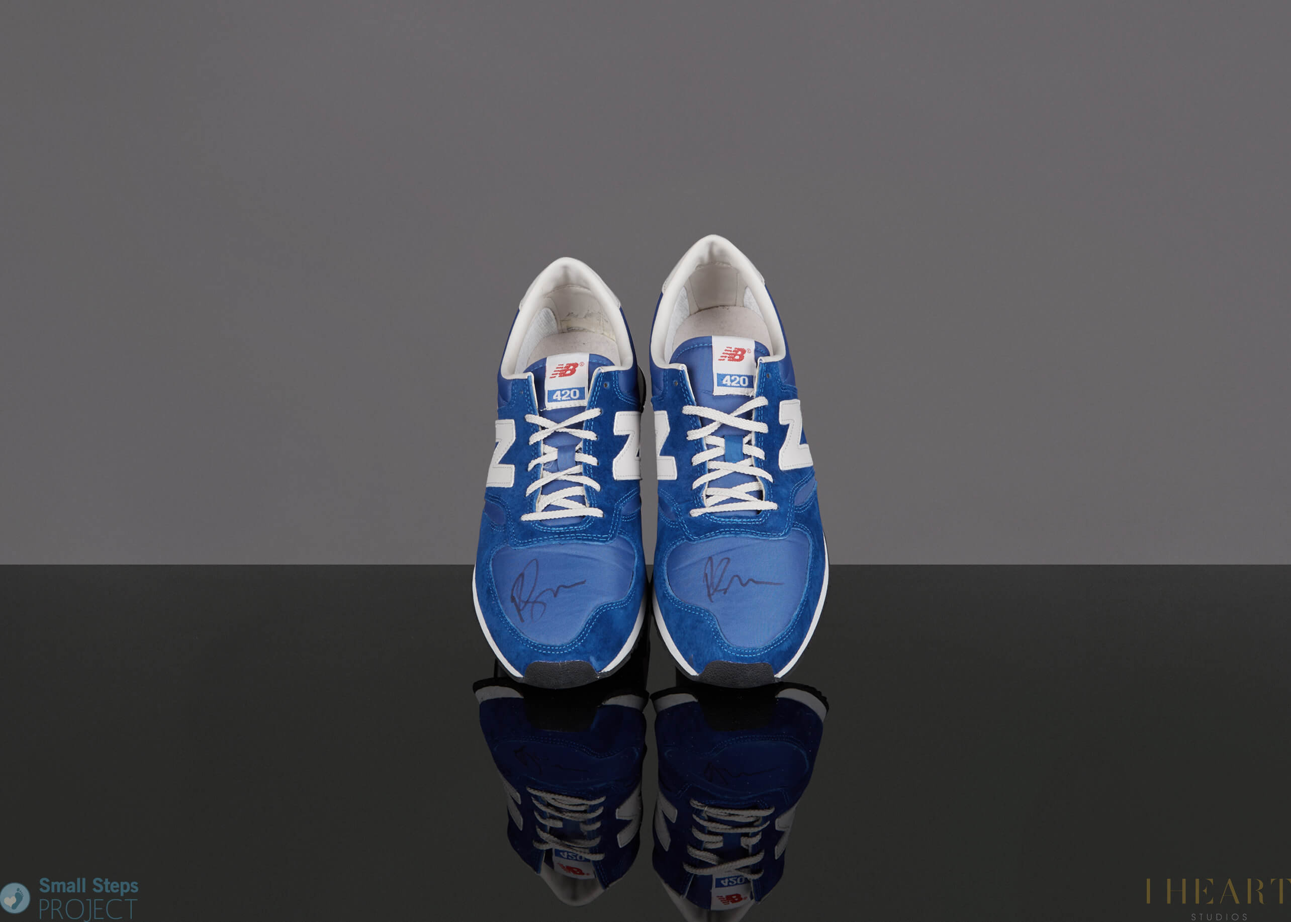 """In 2014 Ricky donated a pair of blue New Balance trainers which are a size UK8. Ricky told us: """"These shoes have run around New York, London & LA. Slowly. One careful owner""""."""