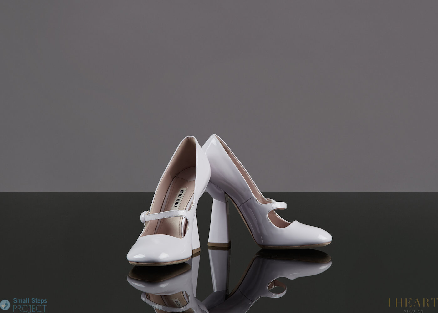 In 2014, Rachel donated a gorgeous pair of white Miu Miu shoes.