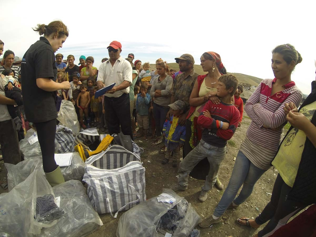 Mihai and Kirstie giving out the boots to each of the 80 families living on the dump.