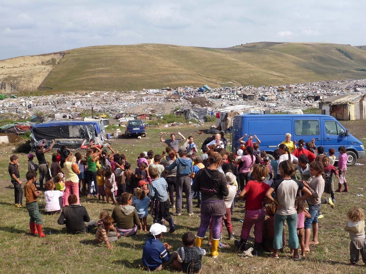 Twice a week the children gather at the top of the hill near the dump and volunteer teachers play games and sing songs with them.