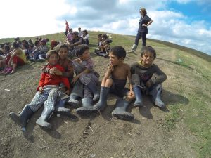 These boys attended the feeding programme with their new boots that they had received the day before.