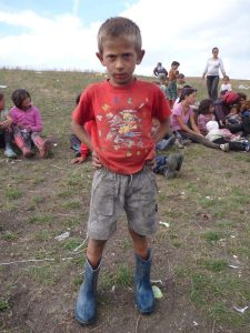 We met this boy the day before with no shoes on his feet at all.