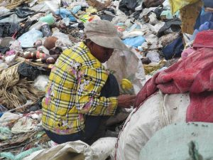The workers on the dump have little protective clothing. Seven truck loads of rubbish are dumped each day.