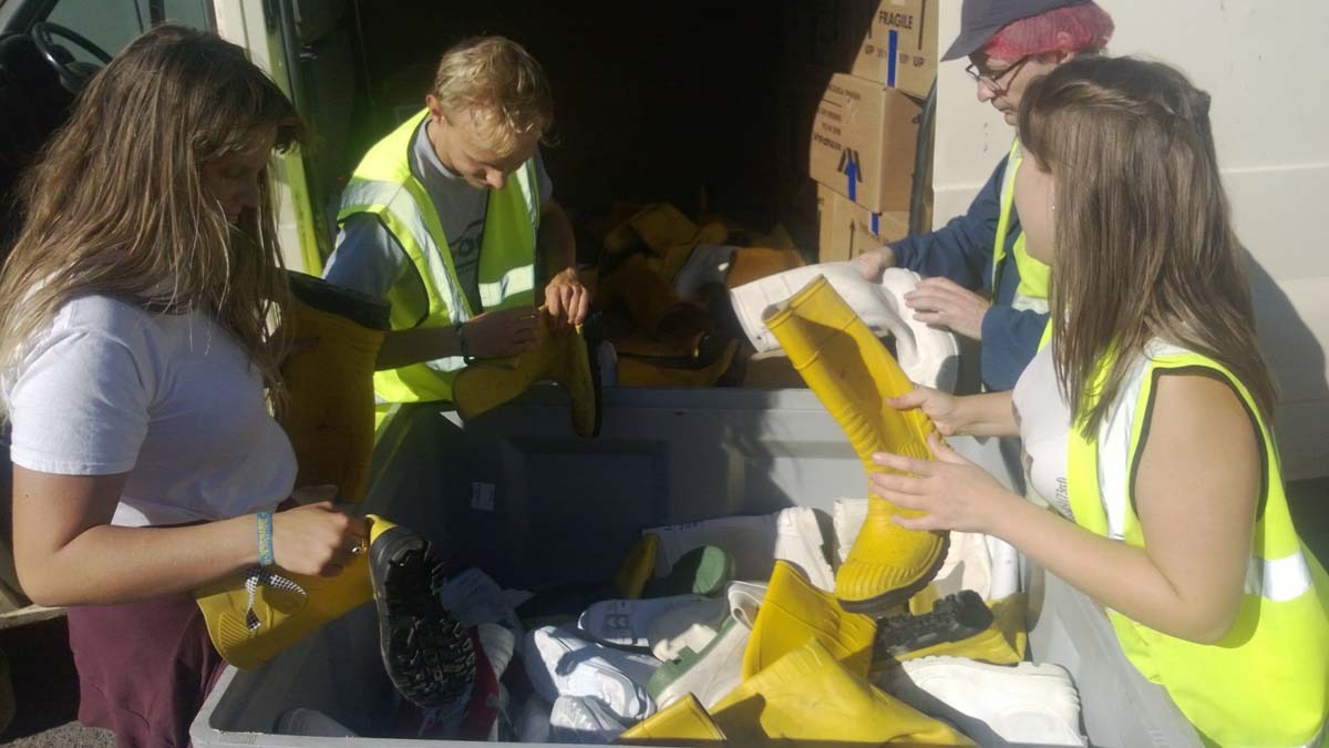 Steffan and his crew sorted and pairs over 600 pairs of boots for Romania.