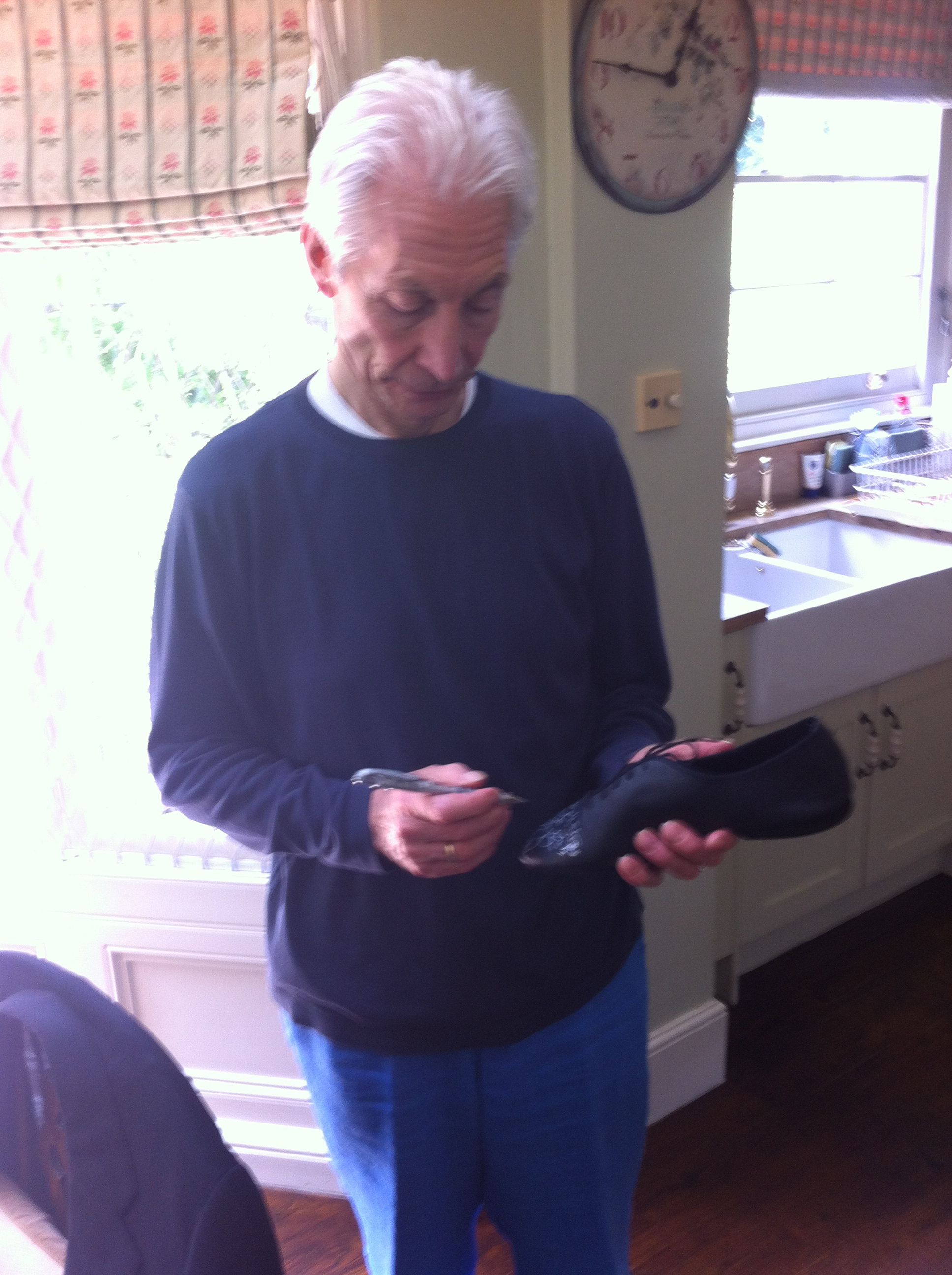 Charlie signing his shoes for the Small Steps Project auction