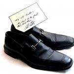 In 2011, Colin donated a pair of shoes with a hand written note to the winner
