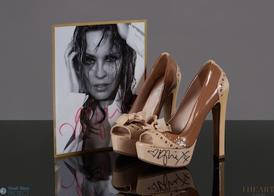 Kylie's signed headshot along with her donated heels