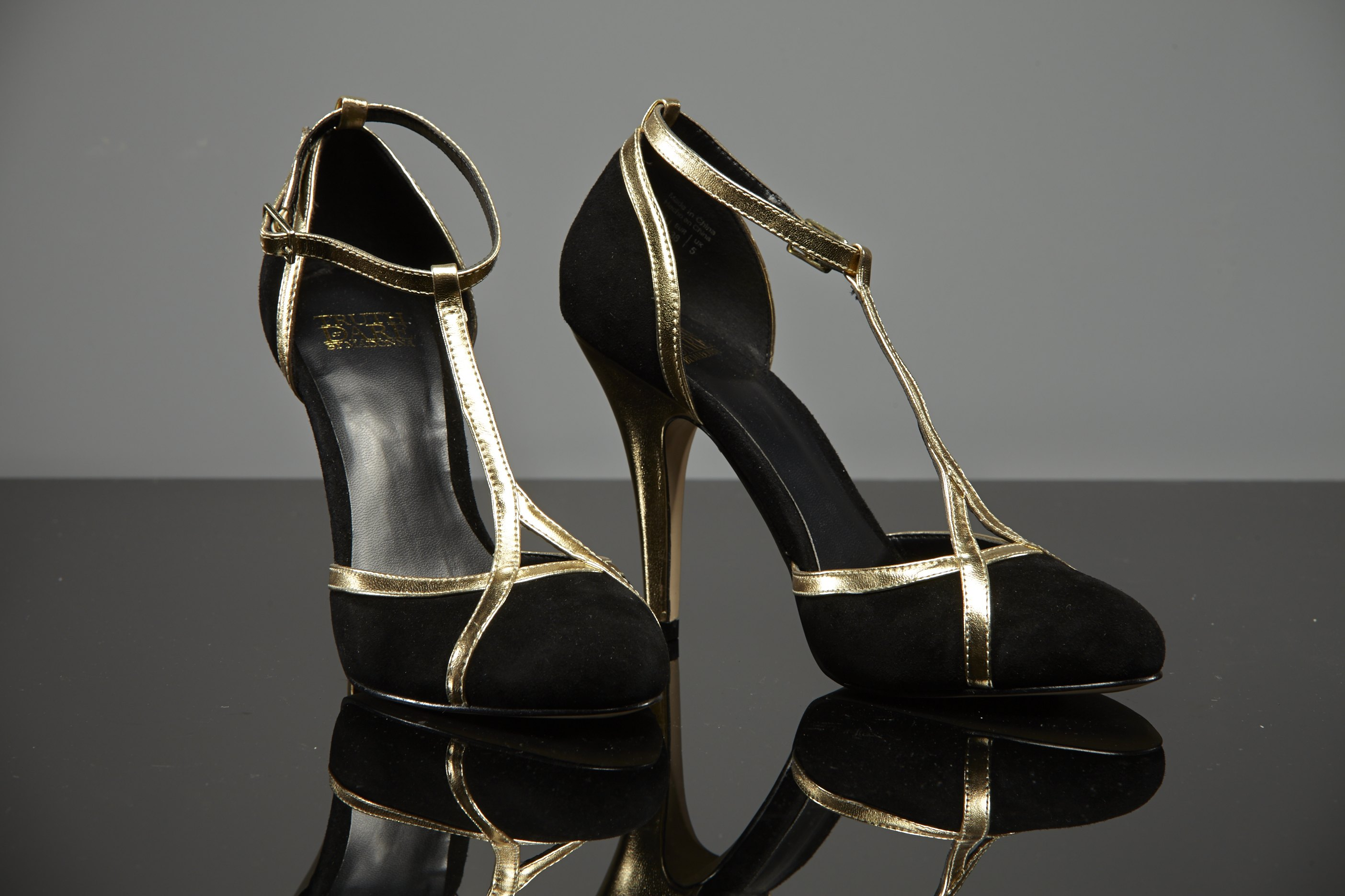Madonna's fabulous black and gold suede heels are a US size 7.5.