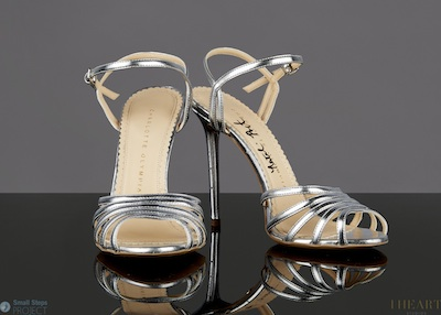 Her silver stilettos are a UK size 4