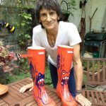 Ronnie Wood with the boots that he painted and donated in 2013