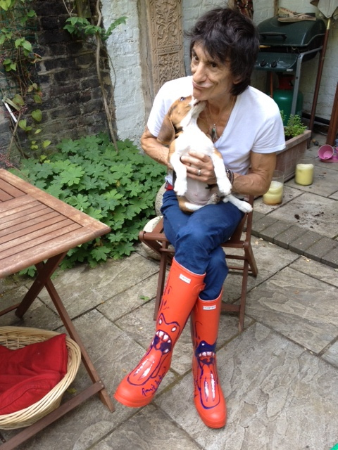 Ronnie wearing the boots that he donated  in 2013