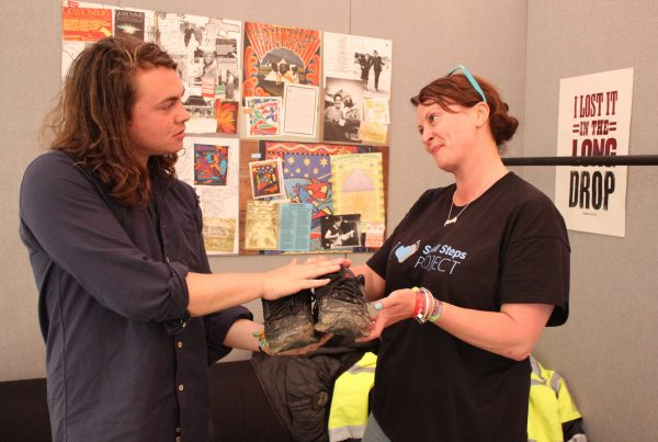 Ed handing his shoes over to SSP's Nicky