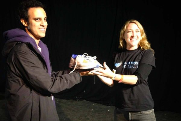 Kieran handing over his shoes to SSP's Amy.