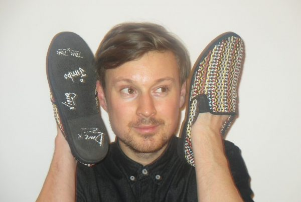 Django's singer and guitarist Vincent Neff with the shoes signed by the whole band