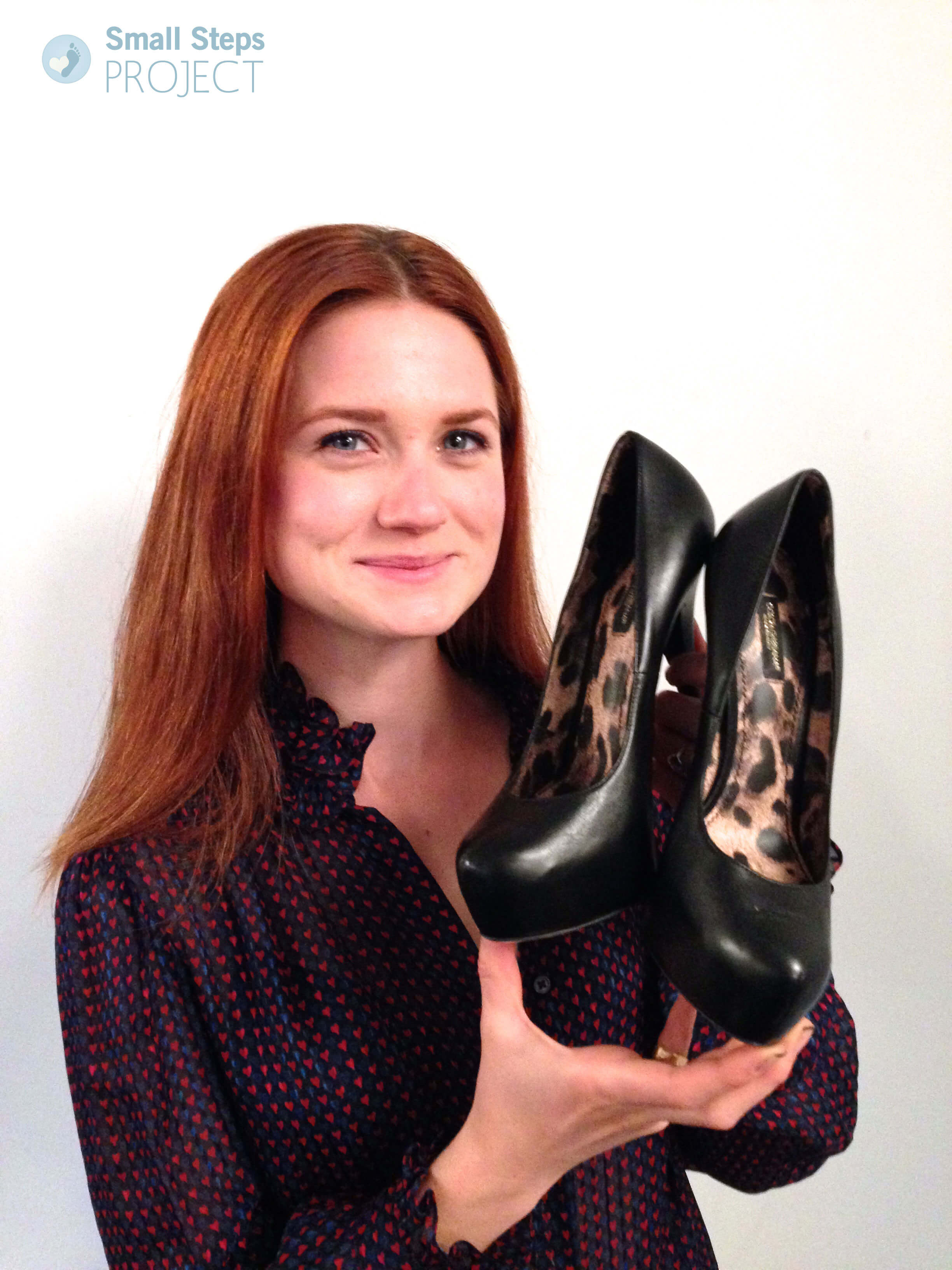 Bonnie Wright with her shoes that she donated in 2014
