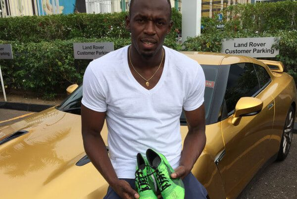 Usain Bolt with his training spikes