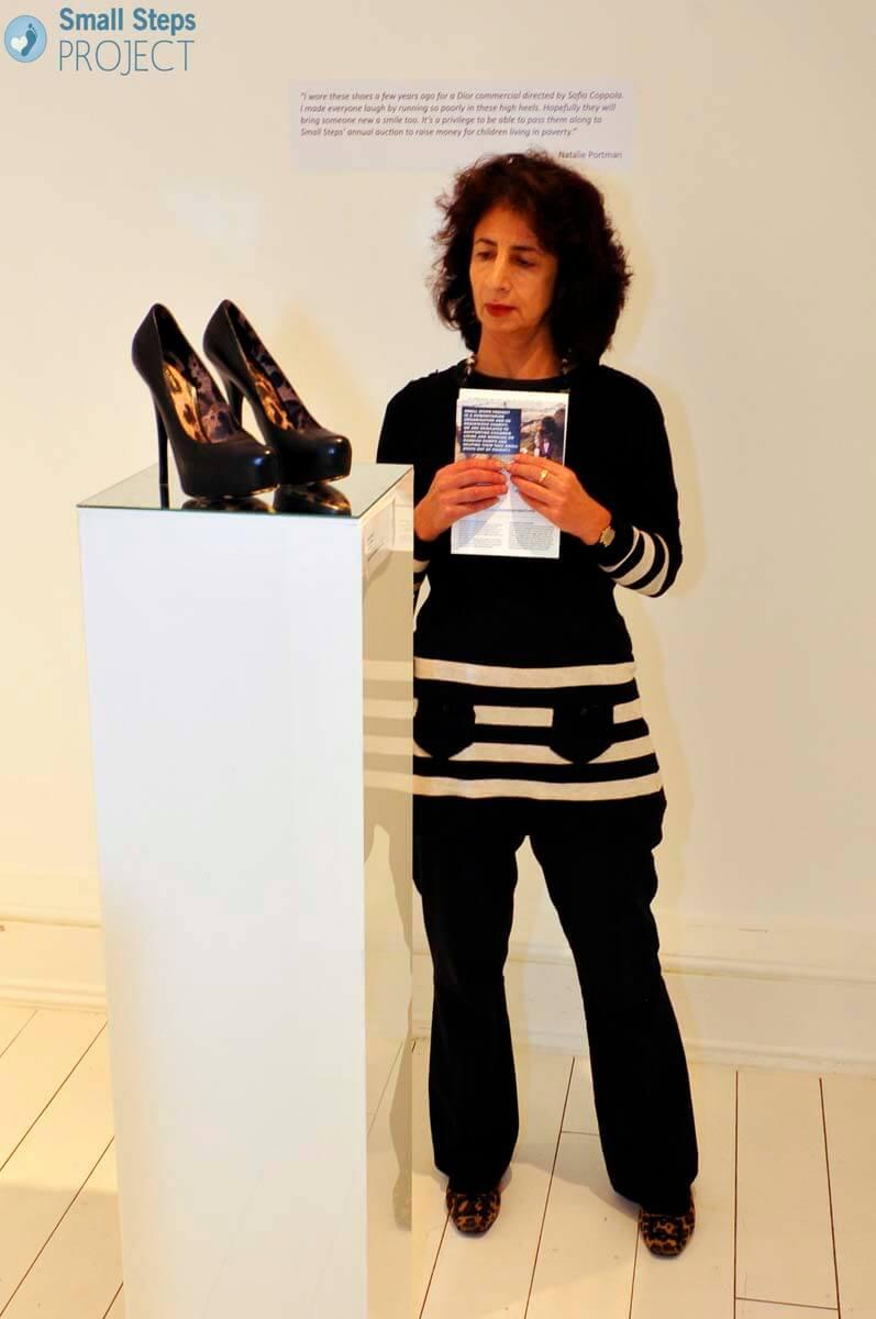 A guest admiring Bonnie Wright's Dolce & Gabbana's.