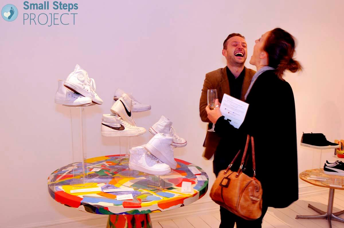 Guests enjoying themselves next to the One D boys' shoes