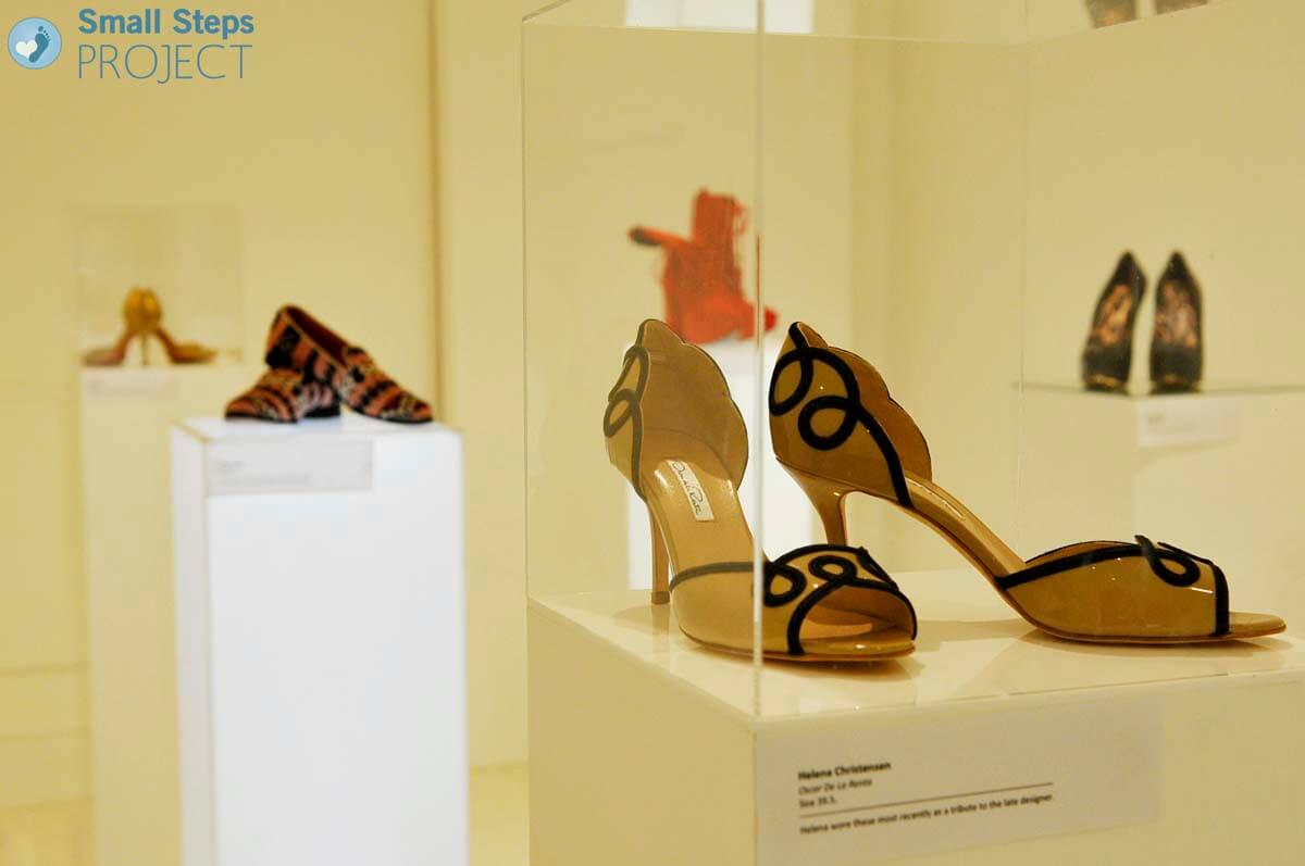 Shoes being exhibited ready to be seen by the public. In the foreground is Helena Christensen's Oscar De La Renta's.