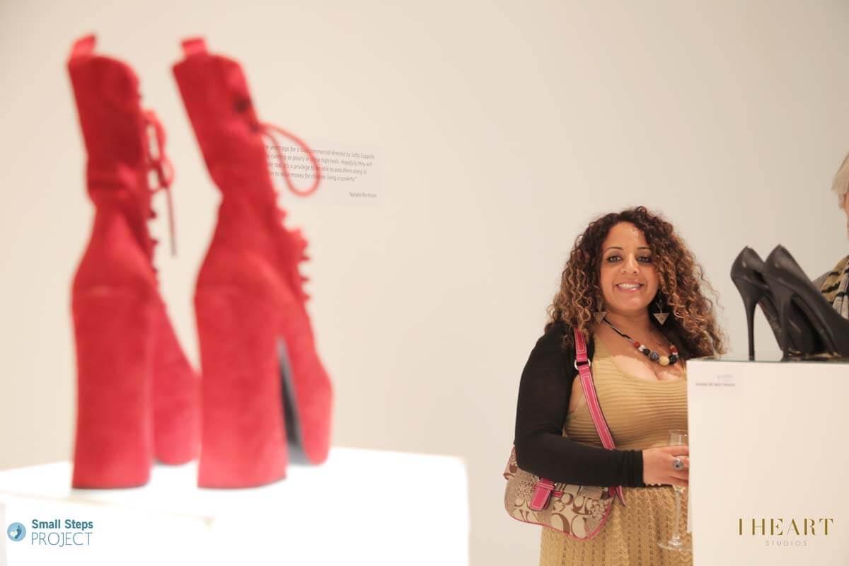 A guest admiring Vivienne Westwood's shoes