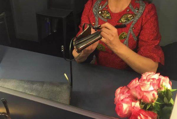 Linda Evangelista signing her shoes