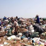 There are approximately 200 individuals working on the KM36 rubbish dump each day.