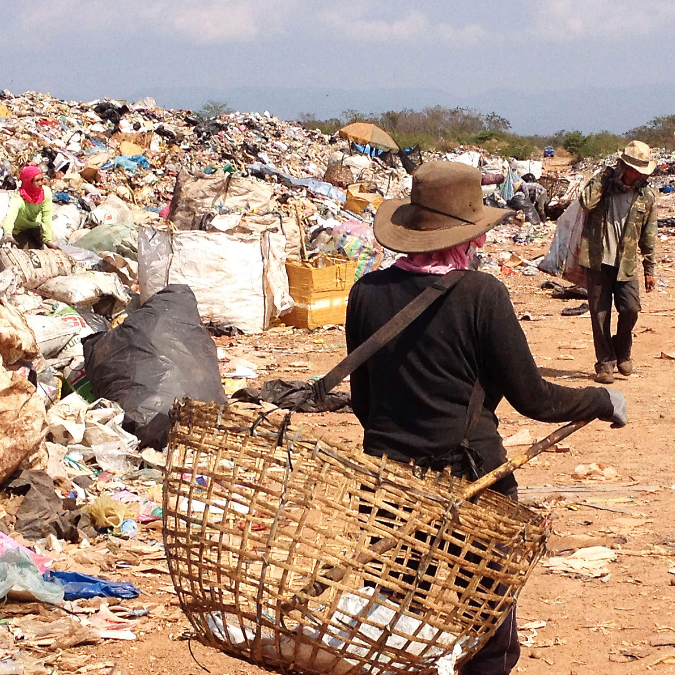 Life on the KM36 rubbish dump is hot and exhausting work.