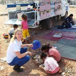 CEO Amy Hanson on site visit with the mobile school and some of the children who are on the rubbish dump.