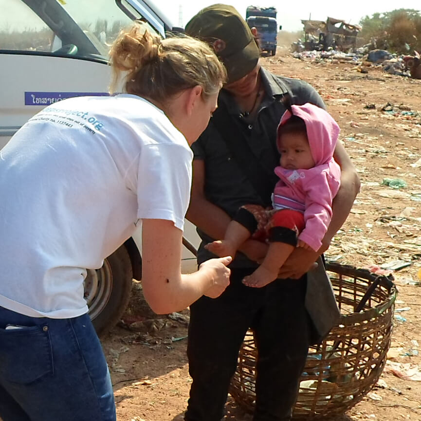 CEO Amy Hanson meets one of the youngest on the KM36 landfill site.