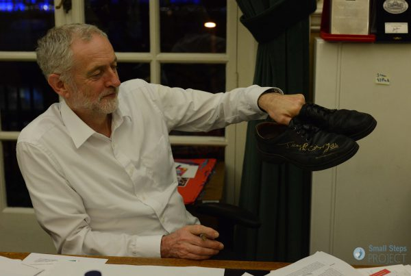 Jeremy Corbyn holding his signed pair of shoes! 2015