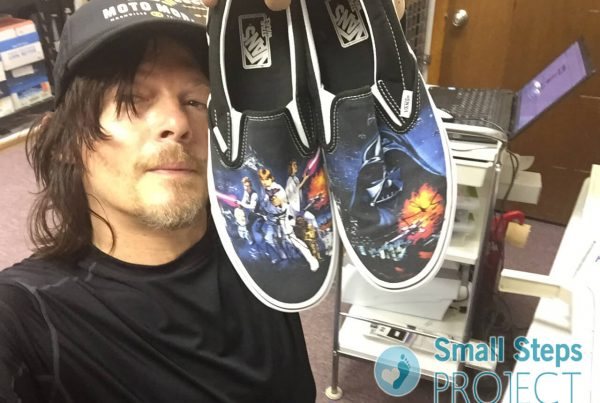 Norman Rheedus holding his donated pair of shoes 2015